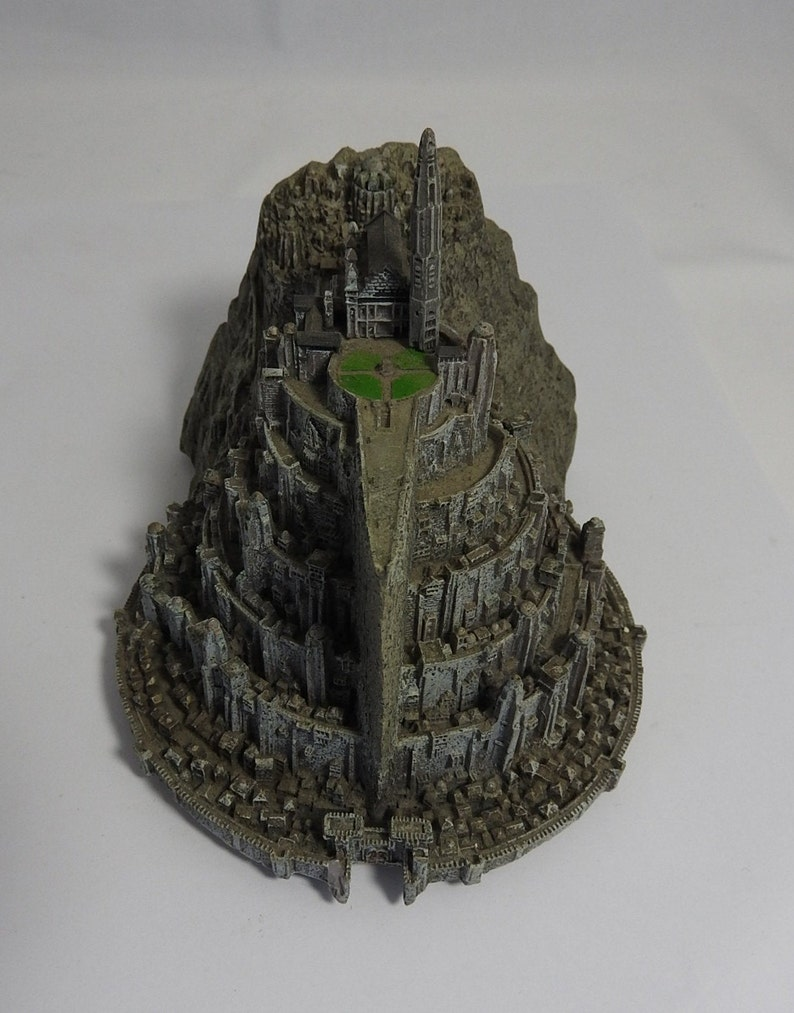 vintage resin small gray ornament  paperweight of the town in the rocks  with a platform for the plane