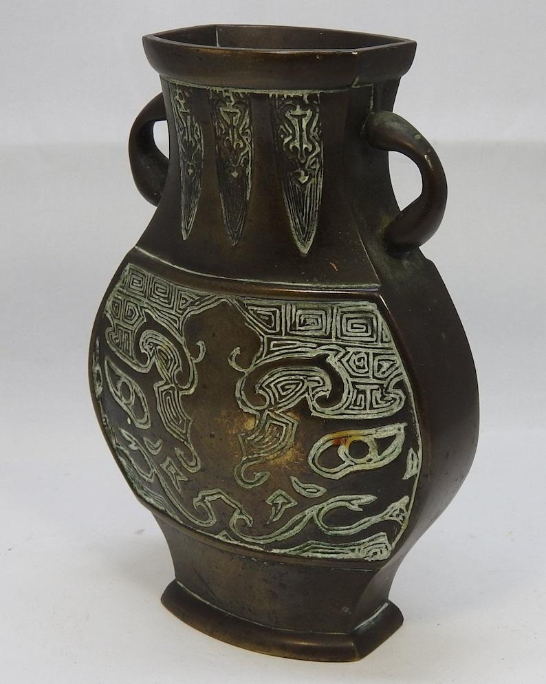 Bronze vase with twin handles