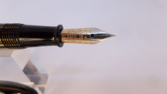 beautiful pen referred to as the Peacemaker in planked and opalecent shades of brown and amber. 1935 Sheaffer 1000 Fountain Pen