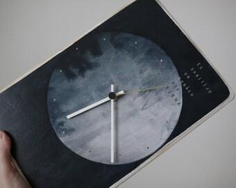 Pulkstenis ar I.Ziedoņa citātu
