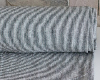 Pure 100% linen fabric 200gsm. Striped linen fabric natural, not dyed with dark gray narrow strips.  Washed and softened linen fabric