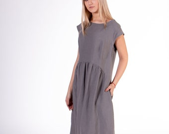 Pure 100% linen dress. Dove gray color. Midi stylish, light-fitting dress from washed linen. Medium length dress with 2 pockets.