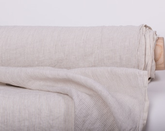 Pure 100% linen fabric 165gsm.  Off-white with narrow vertical natural grey stripes. Dense, strong, washed, softened