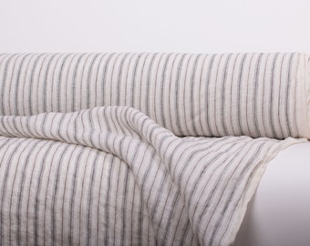 Pure 100% linen fabric 130gsm.  Off-white with grayish, dark brown vertical stripes. Dense, lightweight, stone washed