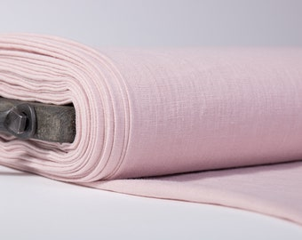 Pure 100% linen fabric ash pink. Linen fabric of medium weight, washed to sew clothing, home textiles. Solid linen fabric by yards or meter
