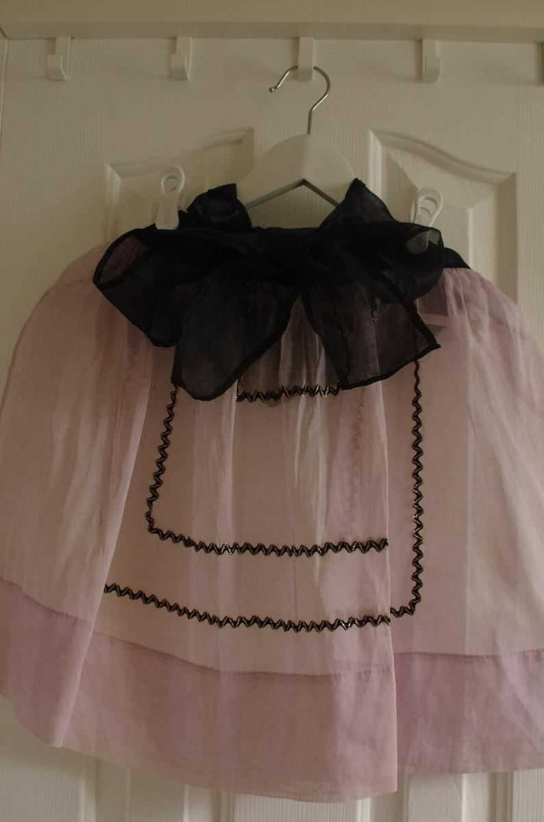 Vintage Half Apron Midcentury Sheer Fancy Hostess Pink Lavender Orchid with black and gold rickrack embellishment trim