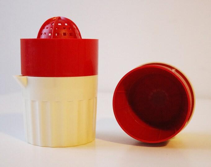 Vintage plastic fruit juicer