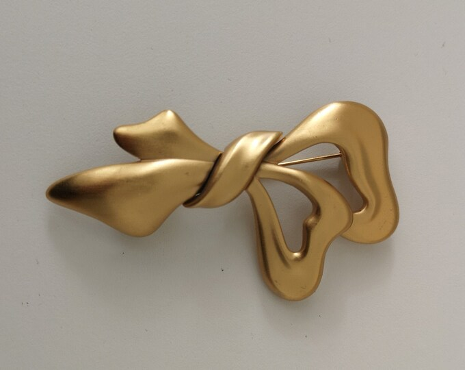 1980s gold plated Monet ribbon / bow brooch
