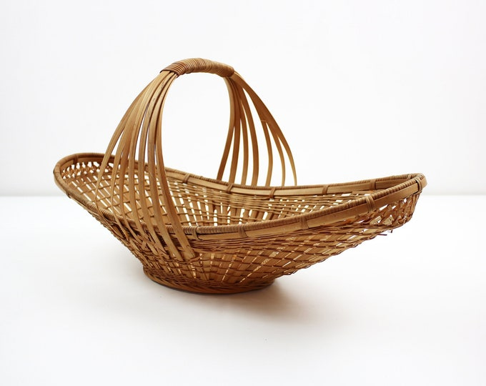 Mid century bamboo / wicker boat shaped bread / fruit basket with handle. Display / storage