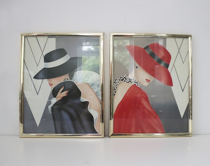 Pair of 1980s art deco revival framed prints - ladies in hats (red and black) signed Ferrazo Ferrero