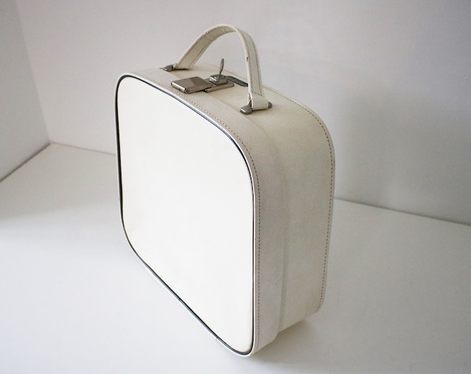 1960s 70s cream overnight / vanity case with black piping, grey paper lining and fabric pocket by Constellation - cabin bag makeup storage