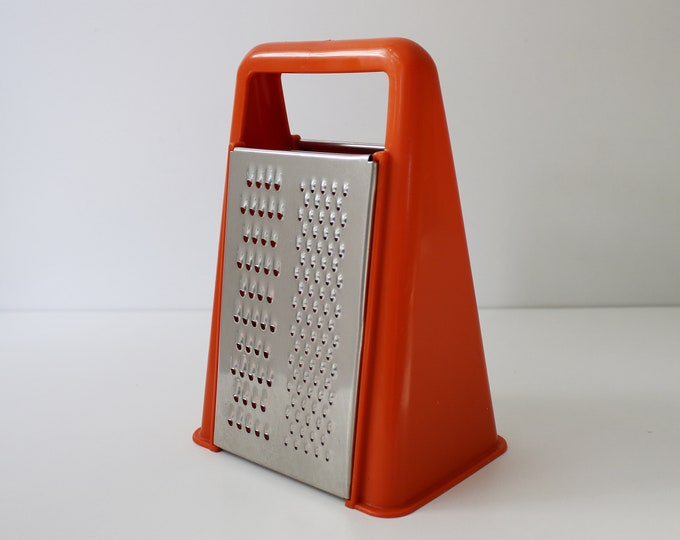 60s 70s orange plastic grater by The Working Kitchen