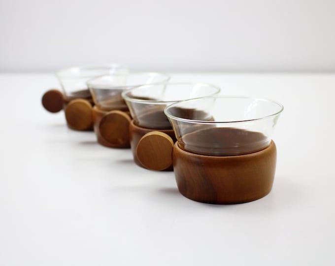Set of 4 mid century glass beakers in wooden cup holders. Schott and Gen Mainz Germany 1960s
