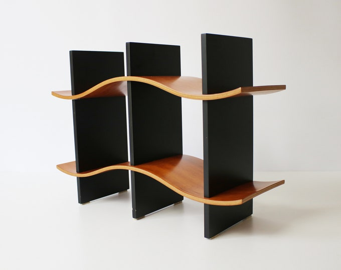 Rare Early 90s 'Soundwave' CD rack in cherry and black designed by Thomas Stender for Modulus (Chicago). 2 available.
