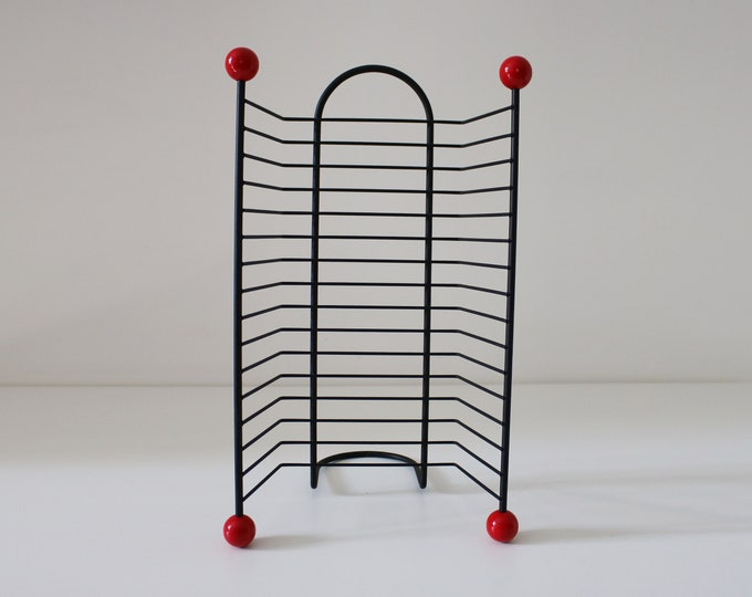 1980s 50s revival DVD rack - black wire metal with atomic red bobbles