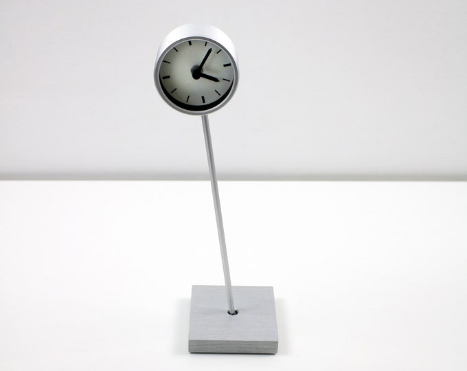 Rorlig post modernist clock from IKEA 2000 - silver lopsided - very rare