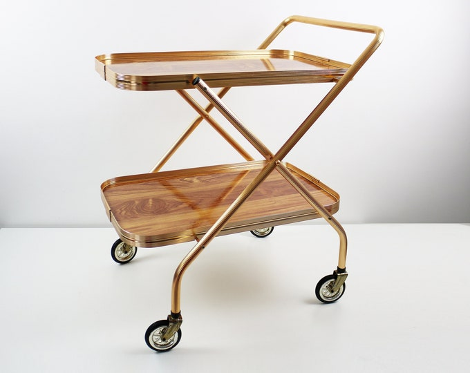 1970s folding drinks trolley / bar cart in gold metal with 2 pine/oak effect laminated shelves