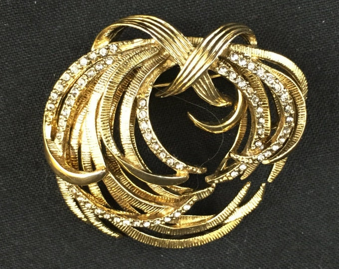 Vintage Monet brooch in goldtone with crystals