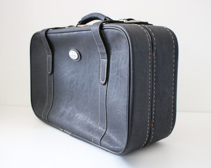 Fab semi-soft shell suitcase in black faux leather with white stitching. Made by Constellation 60s 70s