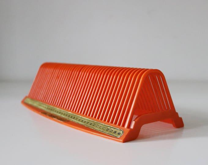 Disk Rak mini 7inch record rack in orange plastic