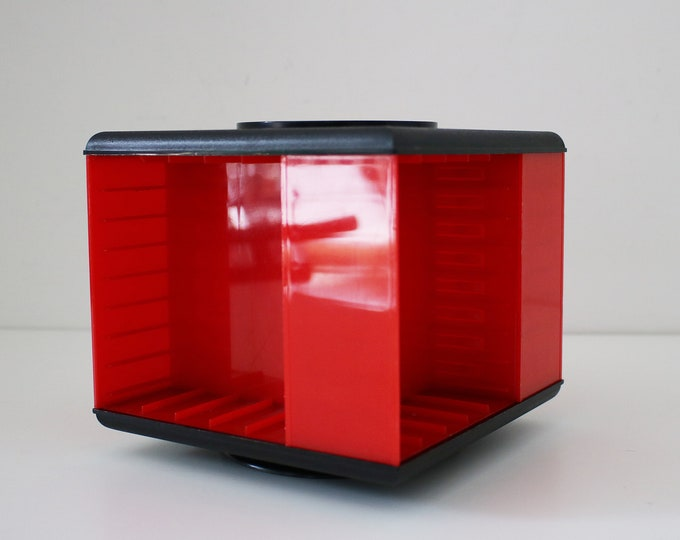 1980s revolving audio cassette tape storage rack in red and black plastic by Waltham