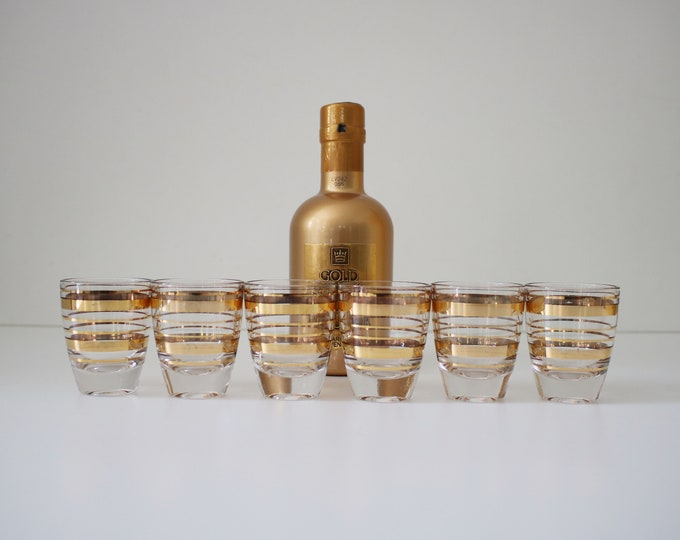 Six vintage shot glasses with gold bands -  bottle not included