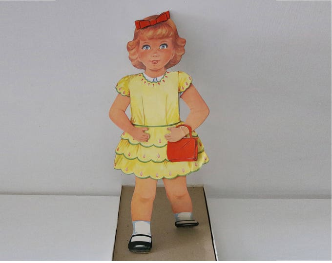 Belinda, vintage stand up dress doll with cut out clothes