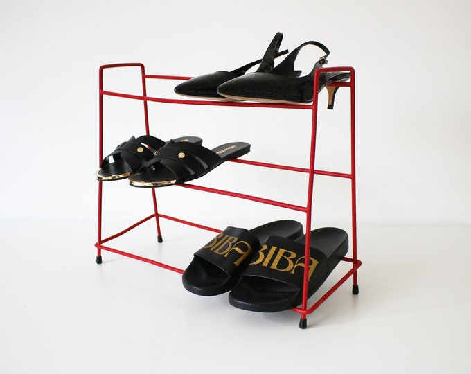 1960s atomic wire shoe rack - red plastic coated wire and black rubber feet