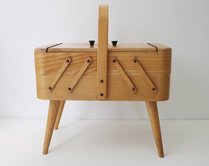 Small mid century art deco style Danish sewing box / jewellery storage. Light wood on atomic sputnik legs