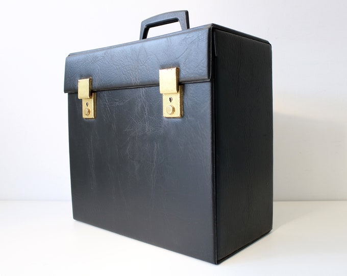 Vinyl revival LP album 12 inch record storage case in black vinyl and metal. Heavier solid version