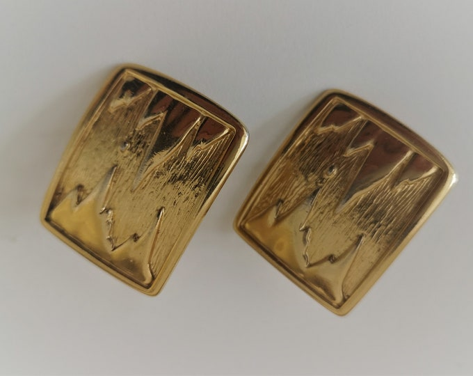 Vintage signed designer clip on earrings by BG Bergdorf Goodman - textured relief gold plated clip on