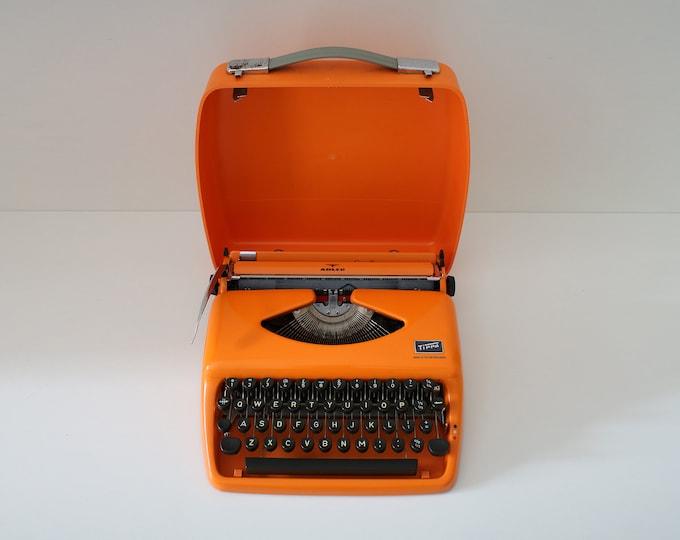 1960s Adler Tippa S bright orange typewriter with case - portable modernist retro