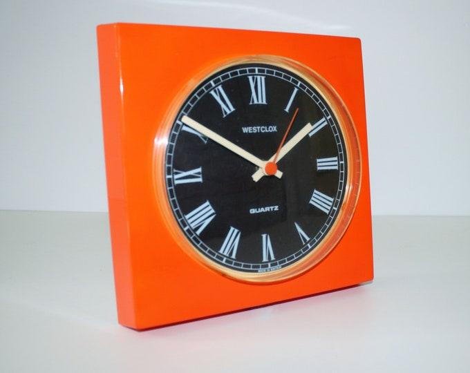1970s Westclox orange and brown plastic wall clock - German quartz movement takes 1 AA battery