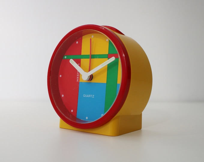 1980s Memphis style clock in bright plastic - working order - small but beautiful - alarm not working