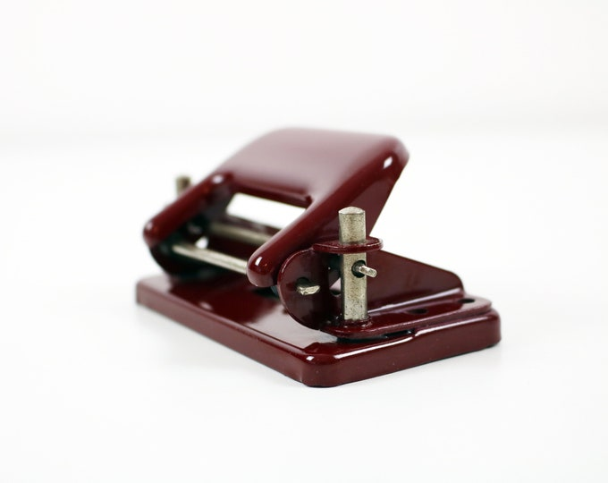 Mid century red metal hole punch from Czechoslovakia - small size