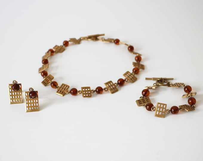 Rare numbered set: Biche de Bere necklace, earrings, bracelet. 1980s / 90s Gold tone grid and amber beads