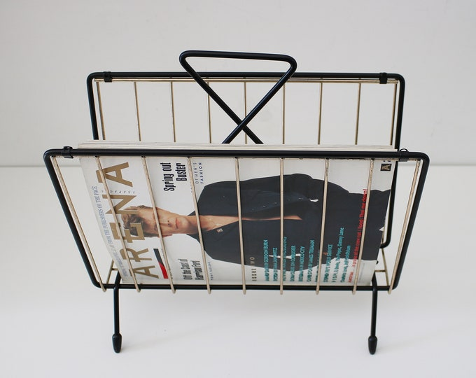 Rare atomic mid century atomic magazine / record rack in black and gold metal