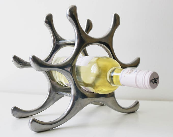 Aluminium wine rack 6 bottle abstract design