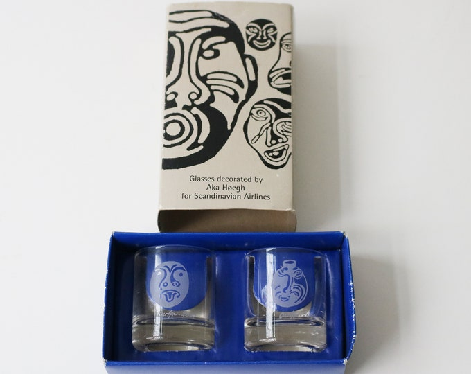 Pair of hand blown shot glasses with Greenlandic mask designs by Aka Hoegh for Scandinavian Airlines