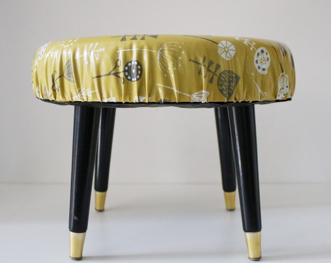 Mid century atomic padded stool by Sherborne with new foam and new retro vinyl covering