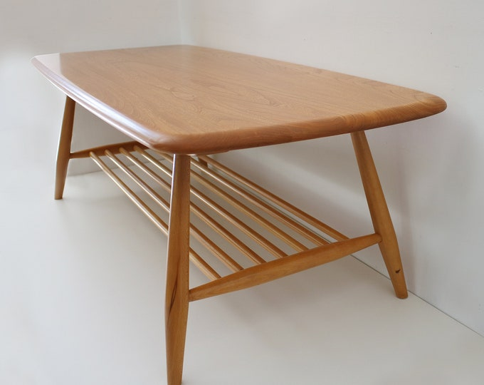 Ercol coffee table with magazine rack in light (blonde) wood. Design 459