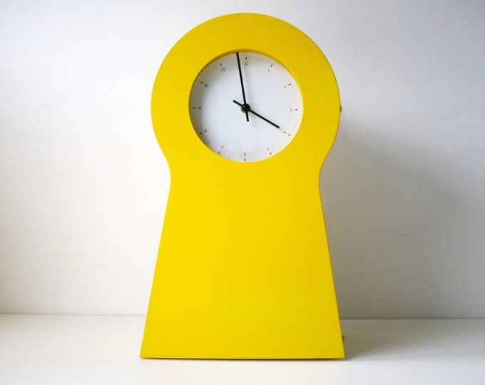 1995 yellow metal keyhole cabinet and clock by IKEA