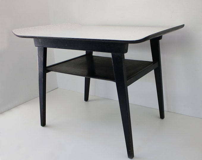 1960s sleigh top coffee table by Myer - atomic laminate with black wooden sputnik legs and magazine shelf