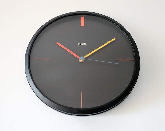 1980s Memphis style minimalist wall clock by Philips - West Germany. Black plastic with primary colours