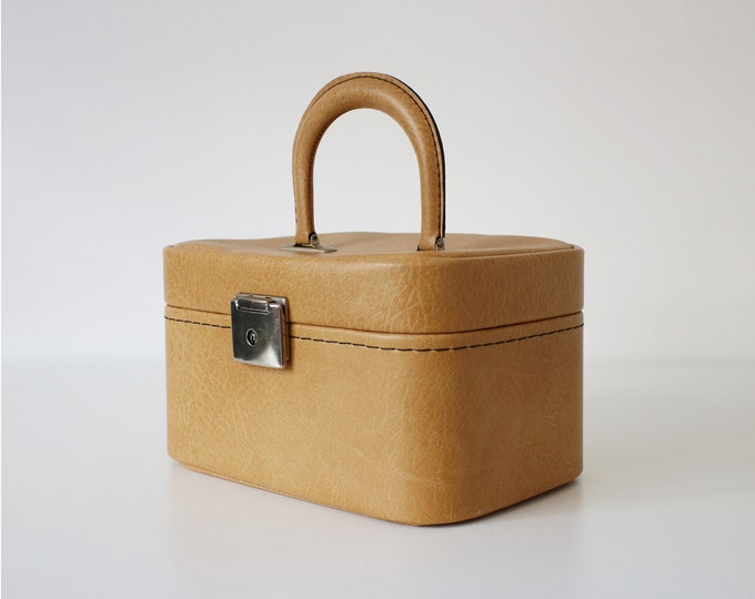 1970s train, vanity, travel case in light tan/ yellow ochre faux leather. Jewellery / makeup