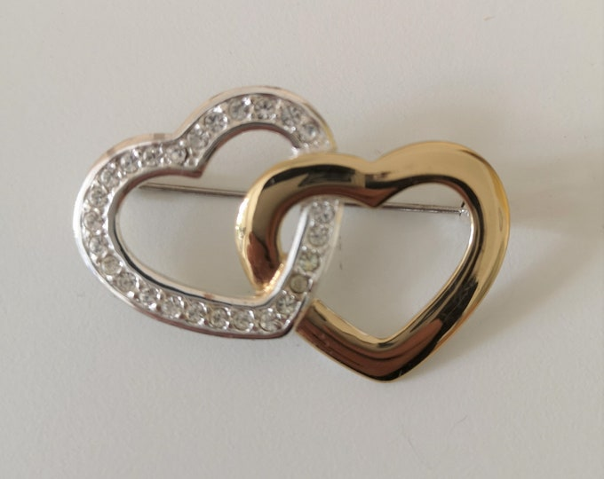 Vintage double heart brooch by Monet. Gold plate / silver tone and rhinestone. Signed