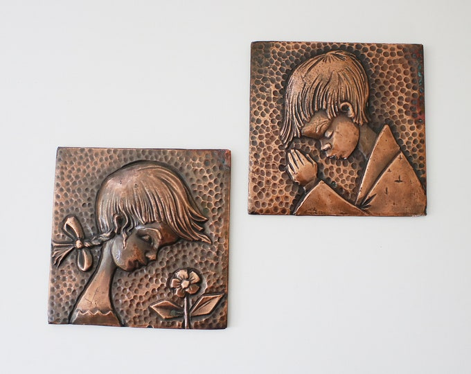Pair of mid century copper wall plaques - stylised girl and boy