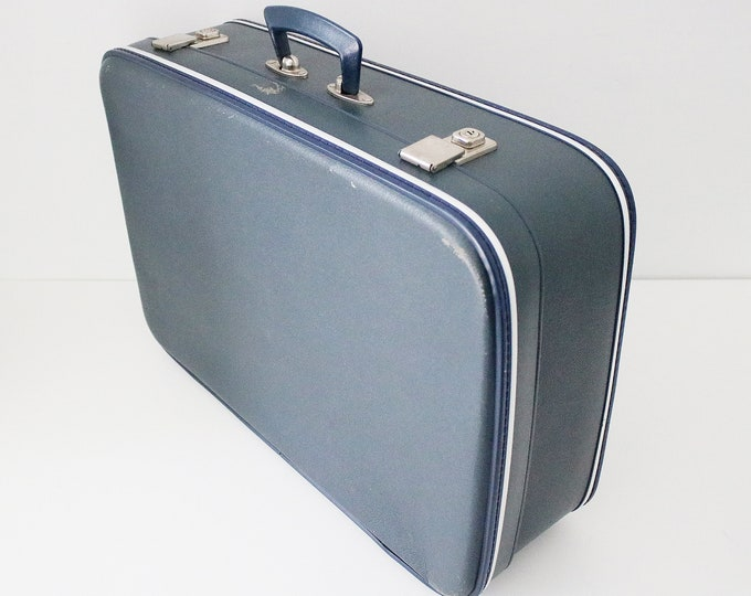 Vintage 60s or 70s hard shell suitcase in blue with silver trim