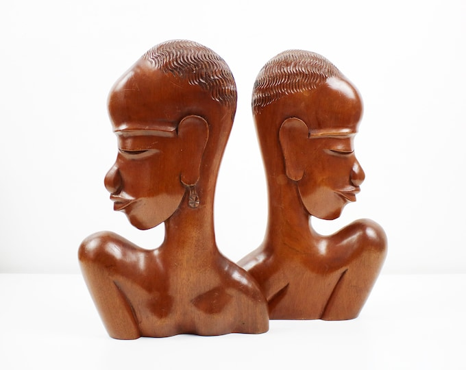 Mid century hand carved wooden African wall plaques - unsigned Hagenauer style - heads pair