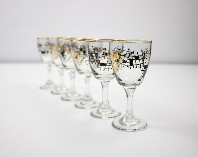 Set of 6 1950s atomic stemmed glasses in black and gold - sherry, port, shots
